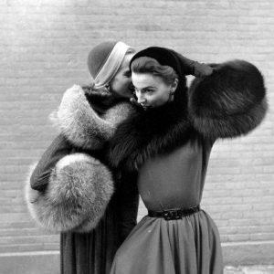ladies with dior fur muffs