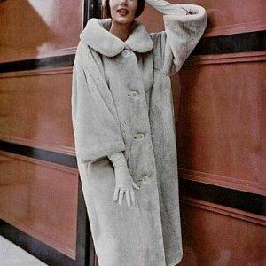 Simone d'Aillencourt in a beige sheared beaver coat by Dior, 1958