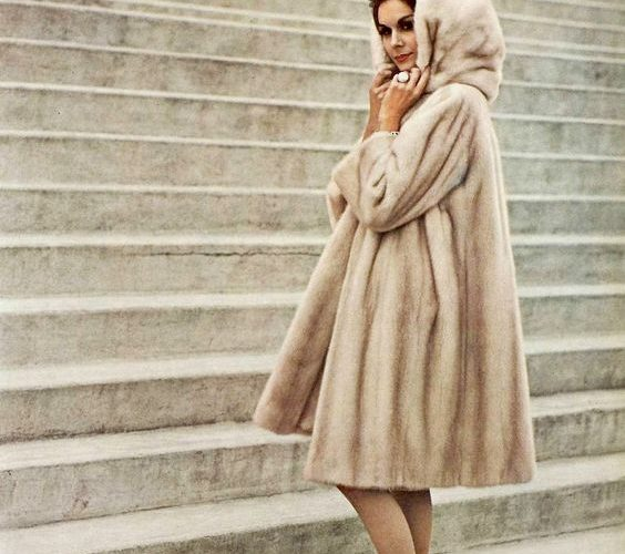 Model in Tourmaline EMBA hooded mink coat by Christian Dior, photo by Georges Saad1961